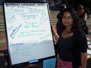 "Usree with the BLC ""Speak another language?"" board, Nadine and Sirpa in the background"